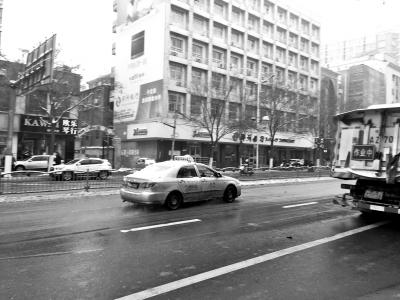 雨雪天气出租车加价能否规范